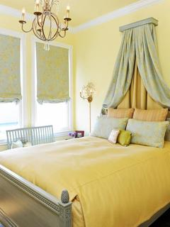 decorations-accessories-bedroom-inspiring-yellow-bedroom-design-with-vintage-style-and-cushions-with-different-pattern-plus-chandelier-with-brass-hanger-material-added-with-fabric-blind-fancy-b.jpg